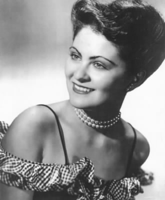 Seattle jazz and swing vocalist Lola Raye, also known as Lola Sugia, married to John Forrest in 1960. Photo taken in 1945. Lola sang with prominent dance bands,  including bands led by Wyatt Howard, Curt Sykes, Max Pillar, Pep Perry, Ken Cloud, Gordon Greene, Jack Hyde Frank Sugia and Norm Hoagy.