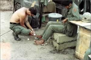 CPT Gary Lattimer MD taking care of a soldier'd ingrown toenail, 1968