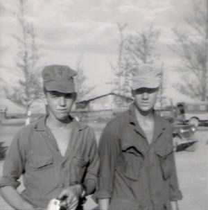 The photo is of Jim Porter and Dan Gallagher at 1st Tanks Area, October 1968