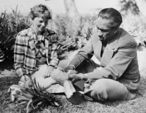 Duke Kahanamoku Eating Pineapple with Amelia Earhart..jpg