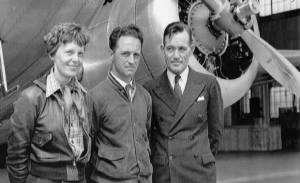Amelia Earhart with navigators Harry Manning, centres, and Fred Noonan in Honolulu i.jpeg