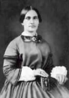 Mary Surratt in dress and displaying Bible.jpg